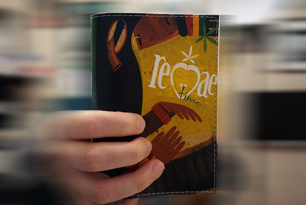 "Photo of cover for passport with Ariadna's illustration ""Reggae time"""